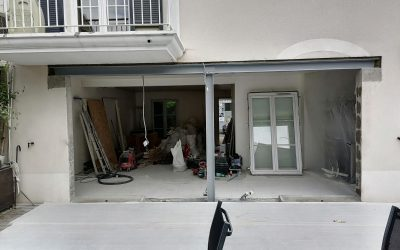 Création d'une ouverture dans un mur porteur de façade. Renforcement par structures métalliques à Carrières-sur-Seine.